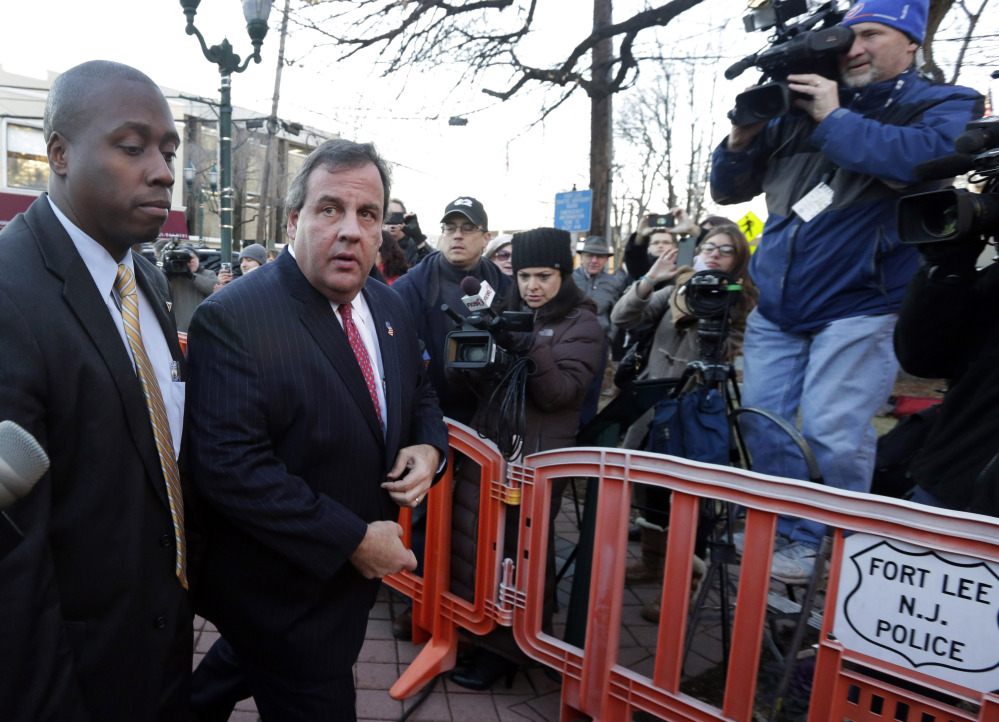 New Jersey Gov. Chris Christie, second left, arrives at Fort Lee, N.J., City Hall on Thursday, where he apologized in person to Mayor Mark Sokolich for the closure of two entrances to the George Washington Bridge that snarled traffic in September.