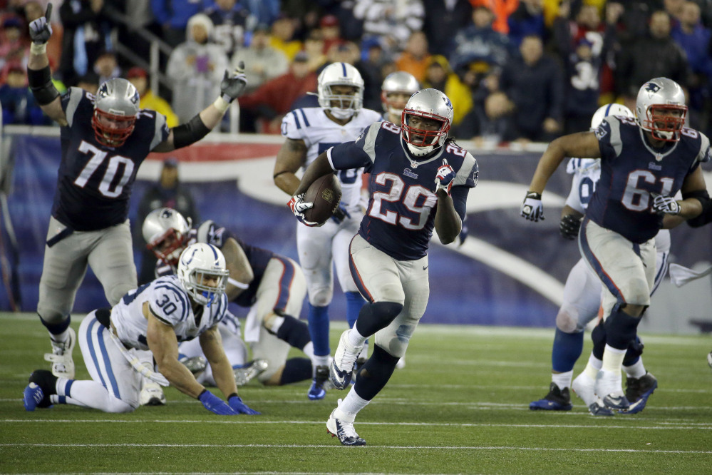 New England Patriots running back LeGarrette Blount (29) heads downfield for a touchdown during the second half of an AFC divisional NFL playoff football game against the Indianapolis Colts in Foxborough, Mass., Saturday, Jan. 11, 2014. (AP Photo/Matt Slocum)