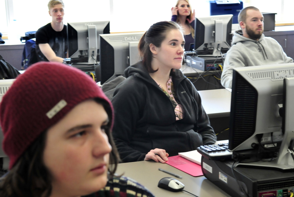 COLLEGE-BOUND: Good Will-Hinckley School student Tia Knowlton-Basford, center, sits among students in an English composition class Thursday at Kennebec Valley Community College in Fairfield. Knowlton-Basford is taking part in the College Step Up program, which helps foster care students take college courses.