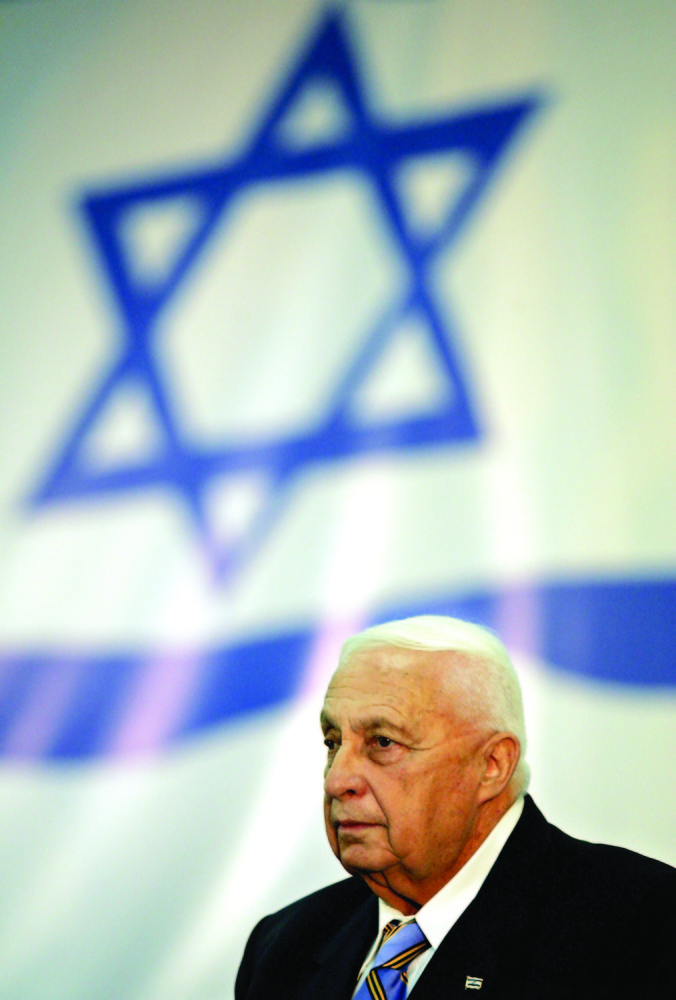 FILE - In this file photo taken Sunday Sept. 25, 2005, Israeli Prime Minister Ariel Sharon attends a Likud Party Central Committee meeting in Tel Aviv. Prime Minister Ariel Sharon's leadership of the governing Likud party is to come up against a stiff challenge Sunday as the party's central committee meets to decide whether to back him or not. Following deliberations Sunday, the committee is to vote Monday on when to hold a party primary. (AP Photo/Ariel Schalit, File)