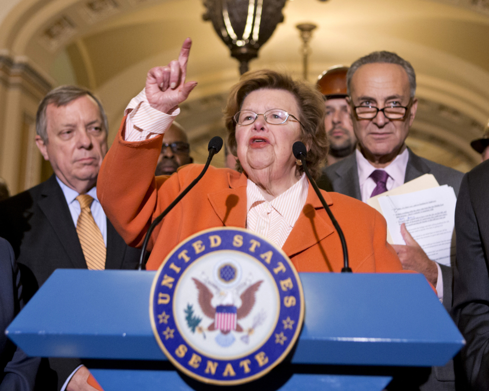"Senate Appropriations Committee Chairman Sen. Barbara Mikulski, D-Md., flanked by Senate Majority Whip Richard Durbin of Ill., left, and Sen. Charles Schumer, D-N.Y., was a chief author of the spending bill. ""We met compelling human needs. We certainly preserved national security,"" she said."