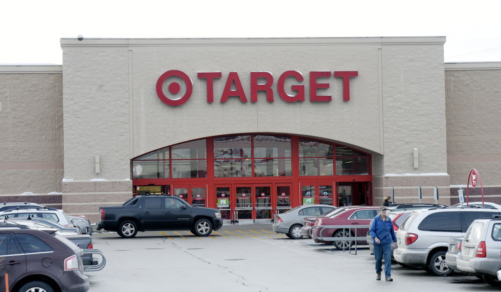 A shopper leaves Target in South Portland on Dec. 19, 2013.