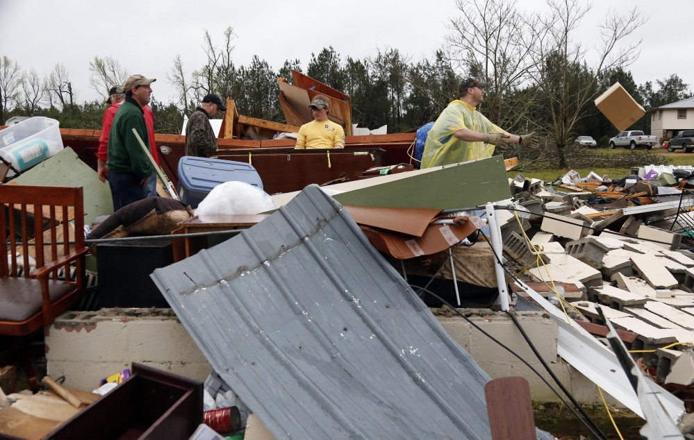 "In this April 11, 2013 photo, Shuqualak, Miss. residents begin cleanup after a tornado plowed through rural sections of eastern Mississippi, killing at least one person and causing widespread damage and power outages, officials said. The Storm Prediction Center plans to broaden its days-in-advance warning system after finding that the days labeled with a ""slight risk"" turned out to have storms that were fairly stout – and even deadly."