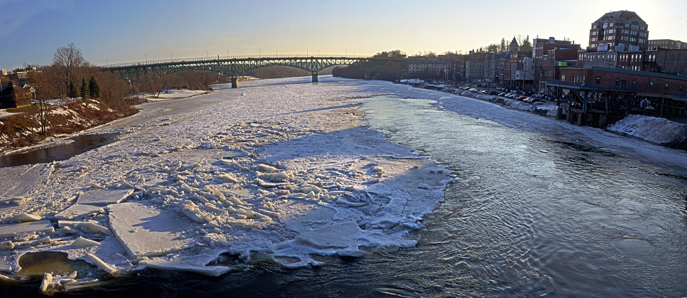 Staff photo by Joe Phelan Slabs of ice the Kennebec RIver in downtown Augusta can be seen piling up in a panoramic photo taken on Friday Jan. 17, 2014 from the Calumet Bridge at Old Fort Western in downtown Augusta.