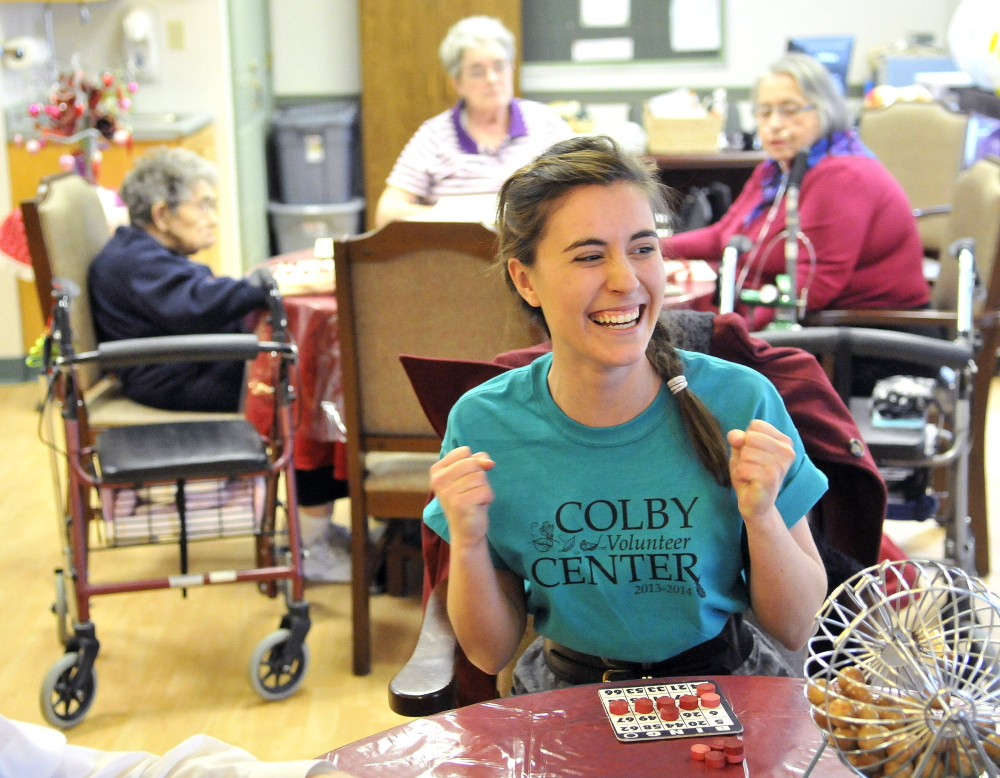 Staff photo by Michael G. SeamansNUMBER CRUNCHER: Colby College senior Theresa Petzoldt, 21, celebrates her victory in a game of bingo during an afternoon of volunteering Saturday at Sunset Home in Waterville. Colby students volunteered throughout Waterville in honor of Martin Luther King Jr.