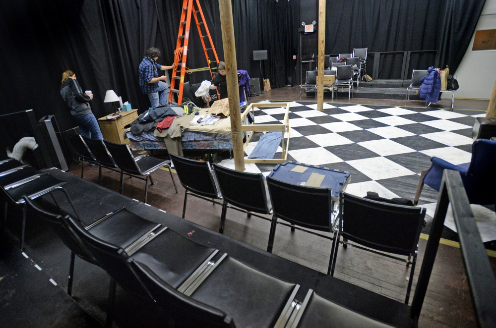"""The cast and crew of the play """"Vigils"""" set up prior to a rehearsal at Mad Horse Theater in South Portland. Mad Horse converted the space after Portland's Lucid Theater went under."""
