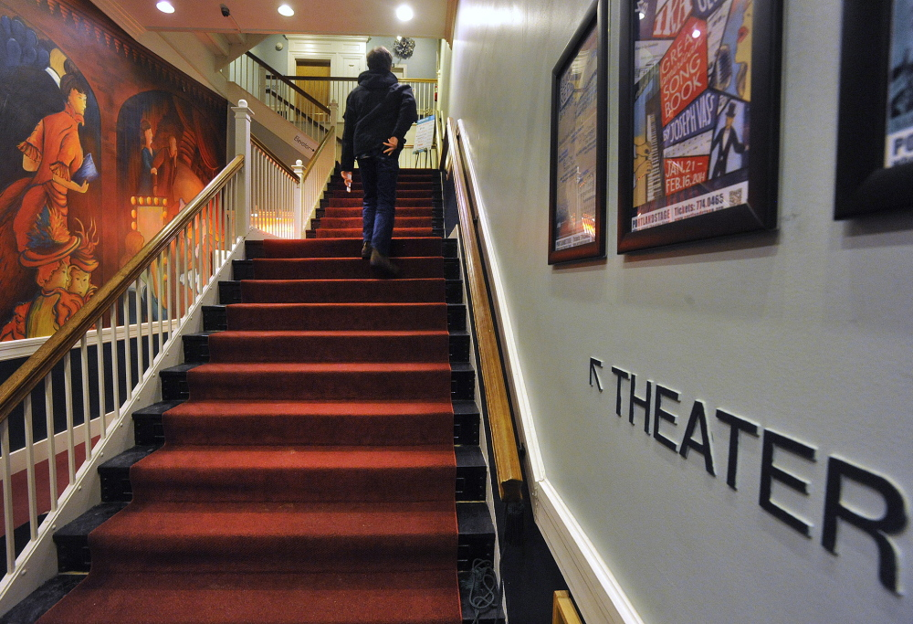 A theater patron climbs the stairs to Portland Stage Company's 75-seat Studio Theater. The company's production manager, Andrew Harris, says his immediate task in 2014 is trying to accommodate all the directors who want to book the theater.