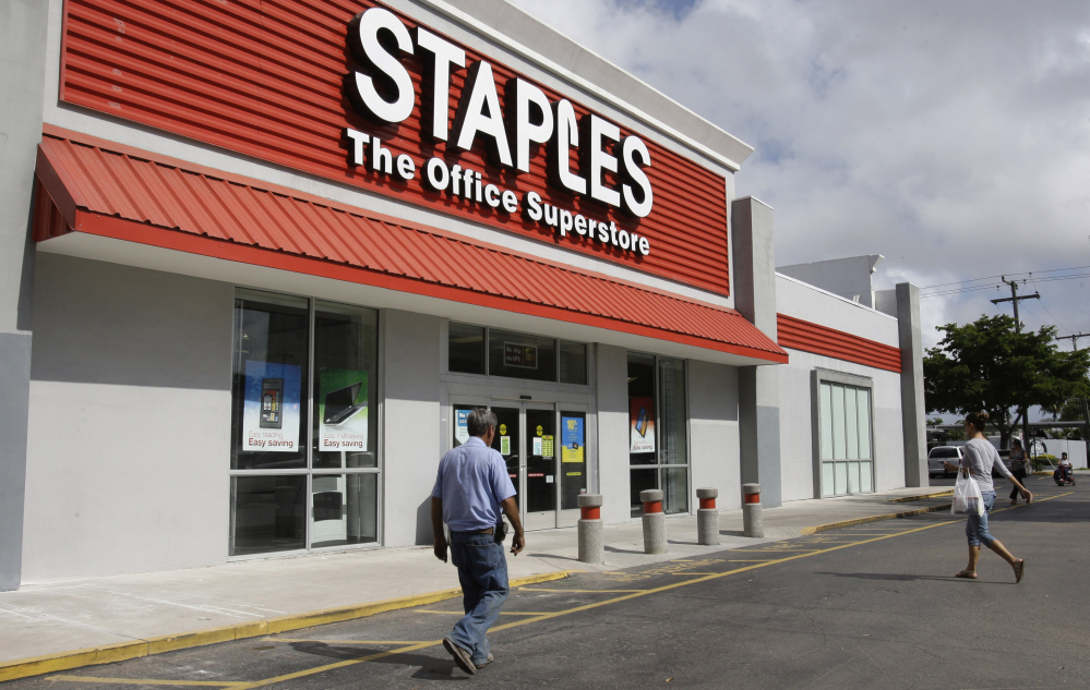 The opening of Postal Service retail centers in dozens of Staples stores around the country is being met with threats of protests and boycotts by the agency's unions. The new outlets are staffed by Staples employees, not postal workers, and labor officials say that move replaces good-paying union jobs with low-wage, nonunion workers.