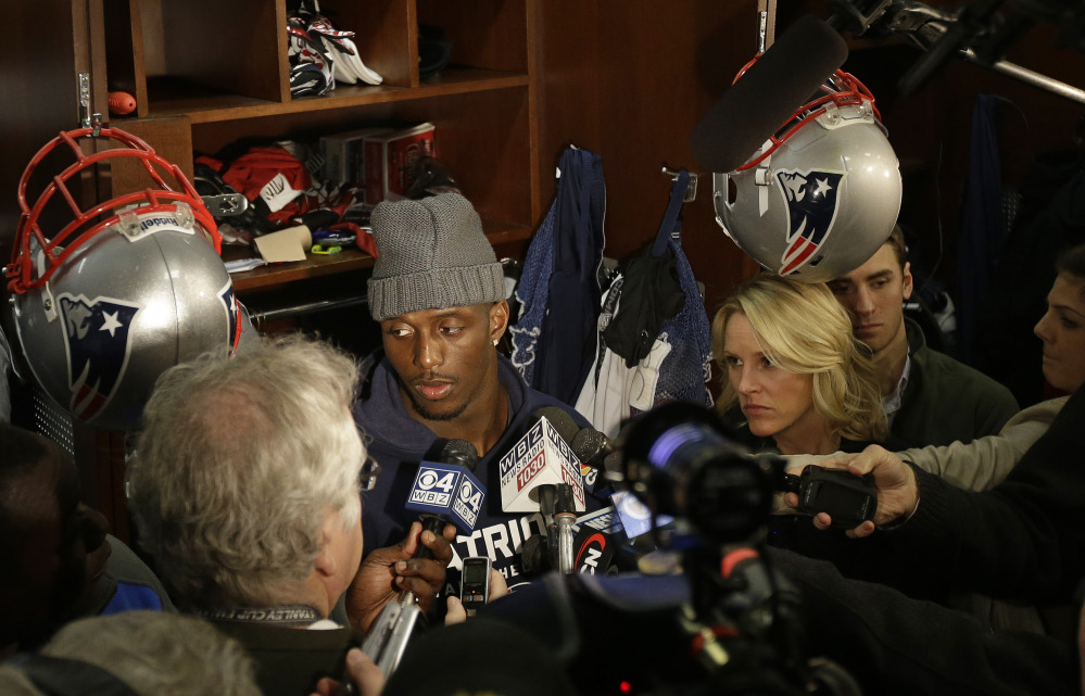 New England Patriots free safety Devin McCourty listens to a reporter's question while standing in front of his locker during a media availability at the NFL football team's facility in Foxborough, Mass., Monday, Jan. 20, 2014. The Patriots lost to the Denver Broncos in the AFC Championship game Sunday in Denver ending their season. (AP Photo/Stephan Savoia)