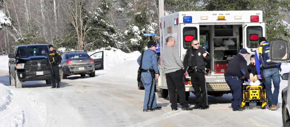 SELF INFLICTED: Edward Domasinsky is loaded into an ambulance with injuries to his face that police say was self inflicted following a domestic dispute with a woman at a residence on the Horseback Road in Clinton on Sunday, Jan. 5, 2014.