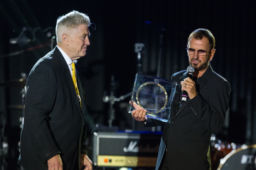 "Director David Lynch, left, presents musician Ringo Starr with the ìLifetime of Peace & Love Awardî on stage during the David Lynch Foundation Honors Ringo Star ""A Lifetime of Peace & Love"" event held at the El Rey Theatre on Monday in Los Angeles."