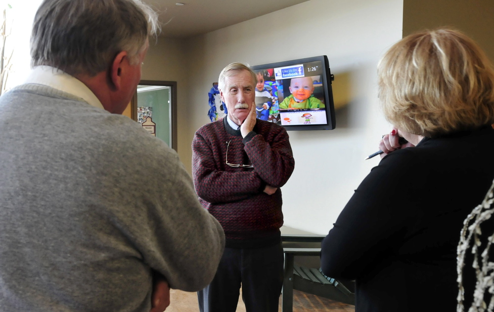 EARLY EDUCATION: U.S. Sen. Angus King, center, listens to comments from Eric Haley, superintendent of AOS 92, and Kathy Colfer of Educare Central Maine during a tour in Waterville on Wednesday, Jan. 22, 2014.