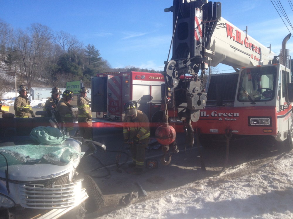 TRAPPED: Firefighters extricate Sally Grouse Thursday, who was trapped after her car collided with a crane on Route 9 in Chelsea. Crews worked for a half-hour to remove her from her totaled PT Cruiser.