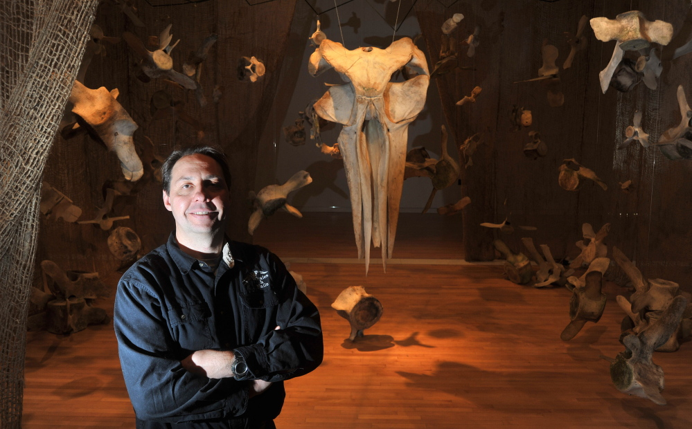 A REAL SKELETON CREW: Dan DenDanto stands with his whale bone exhibit Friday in the Flex Space at the Emery Community Arts Center at the University of Maine at Farmington. The exhibit, which DenDanto and his brother Frank created, features native whales from the Gulf of Maine. Visitors are encouraged to touch and move pieces in the hands-on exhibit.