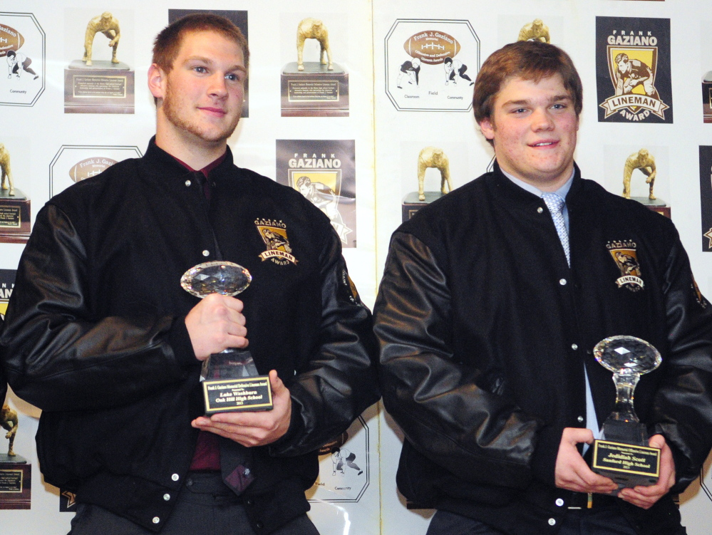 Staff photo by Joe Phelan Oak Hill defensive lineman Luke Washburn, left, and Sanford offensive lineman Jedidiah Scott won the Gaziano Lineman Awards on Saturday January 25, 2014 in the Augusta Civic Center.