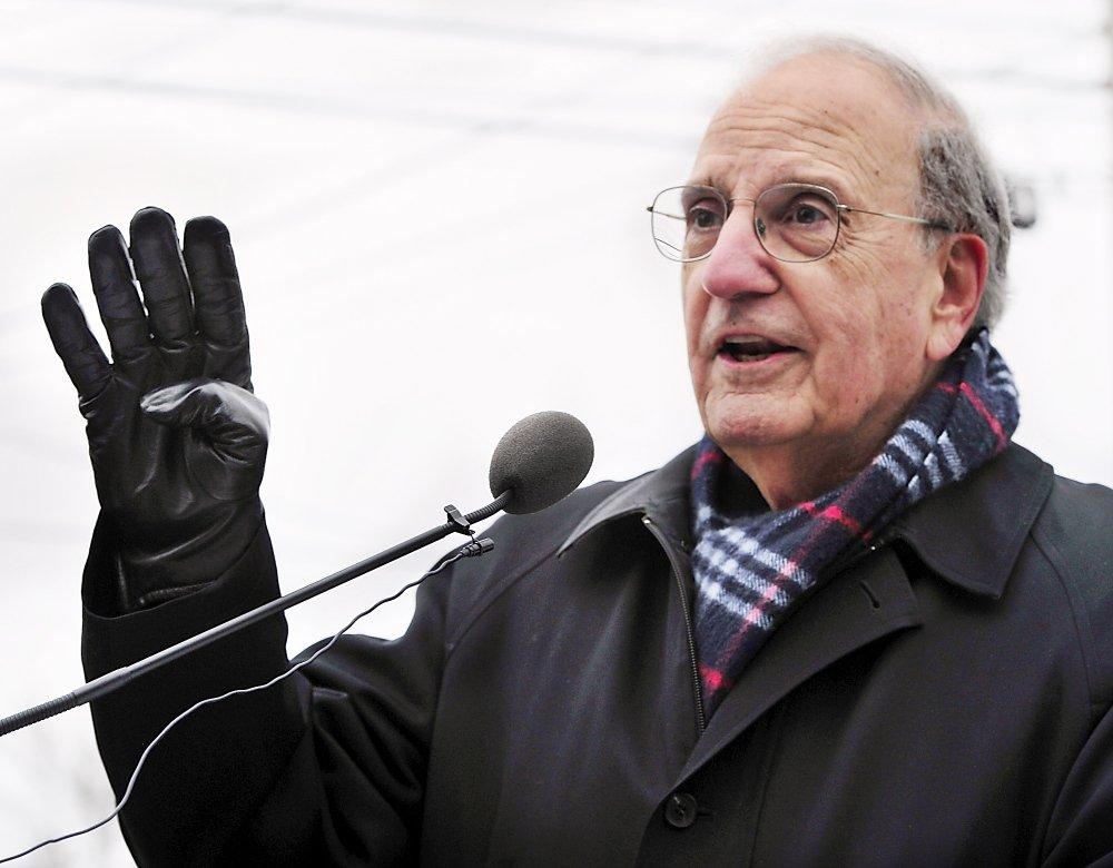 Former Sen. George Mitchell attends a Red Sox rally on Saturday at Hadlock Field, where Boston's three World Series trophies were on display.