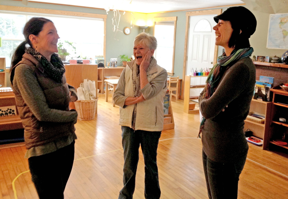 Carrying on: Bethany Mahar, from left, Kate Hatfield and Polly MacMichael laugh over good memories of Samantha Wright at the Maine Mountain Children's House, a nonprofit Montessori preschool program in Kingfield that Wright founded. Wright was killed in a car accident Jan. 6.