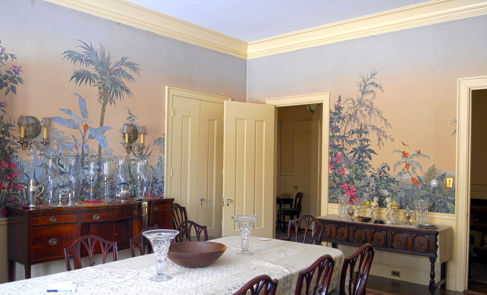 the dining room with tropical wallpaper on Thursday January 23, 2014, in the Daniel Cony Weston House on Stone Street that's home to the Elsie & William Viles Foundation in Augusta.