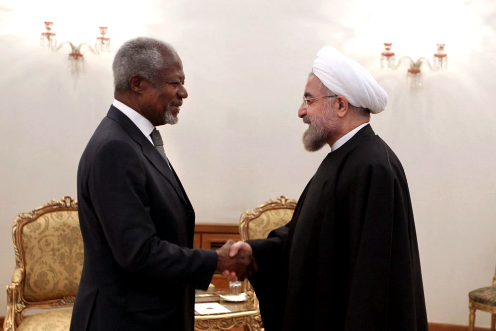 Former U.N. Secretary General Kofi Annan, left, shakes hands with Iranian President Hassan Rouhani at his office, in Tehran, Iran, on Tuesday. Iran denies it is making a bomb and says it is pursuing nuclear capabilities for peaceful purposes.