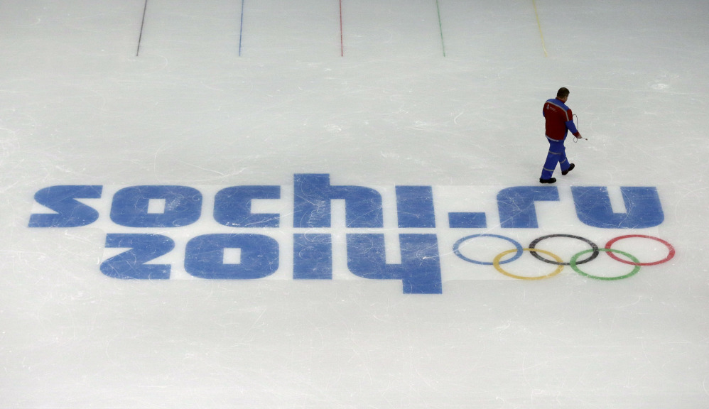 This file photo of is a worker leaves after checking ice conditions at the Iceberg Skating Palace, where the figure skating and short track speed skiing will take place, at the 2014 Winter Olympics in Sochi, Russia.