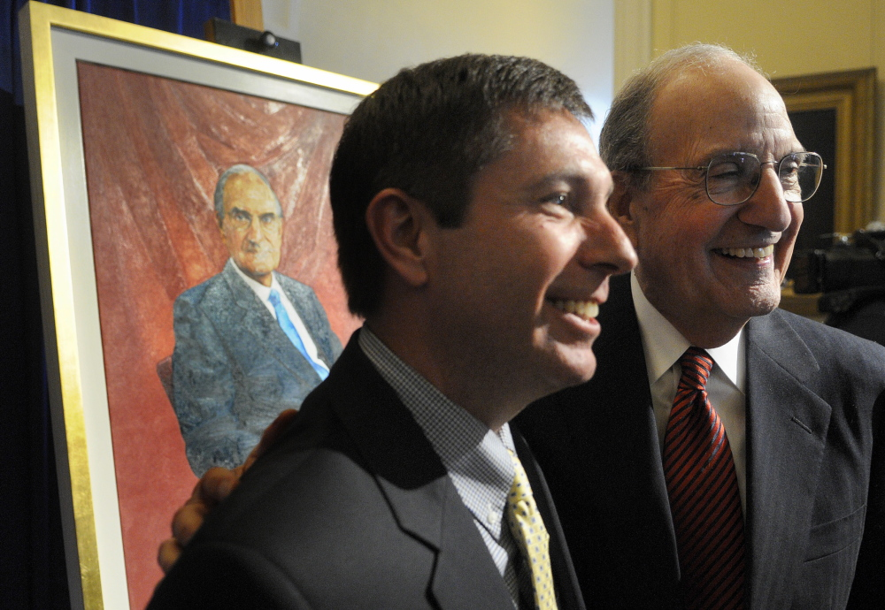 ON DISPLAY: Former US Senator George Mitchell, right, greets Maine House Representatives minority leader Ken Fredette, R-Newport, Tuesday after the unveiling ceremony for Mitchell's official portrait at the State House in Augusta.