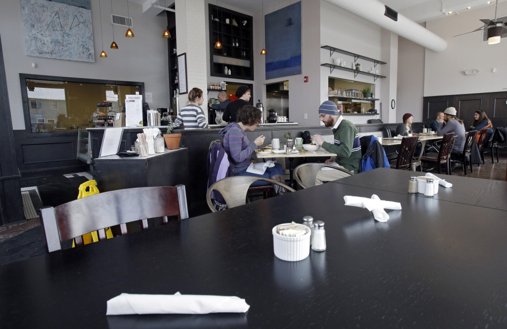 Customers eat lunch at Bonbon Pastry and Cafe in Cleveland. At the cafe in the city's Market Square district, last weekend was especially slow with whiteout conditions making going outside unappealing for customers.