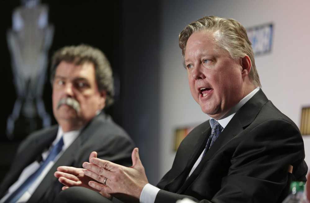BIG CHANGE: NASCAR CEO Brian France, right, answers a question as NASCAR president Mike Helton, left, listens during a news conference at the NASCAR Sprint Cup auto racing Media Tour on Thursday in Charlotte, N.C. NASCAR will have a new, winner-take-all Chase for the Sprint Cup championship beginning this year.
