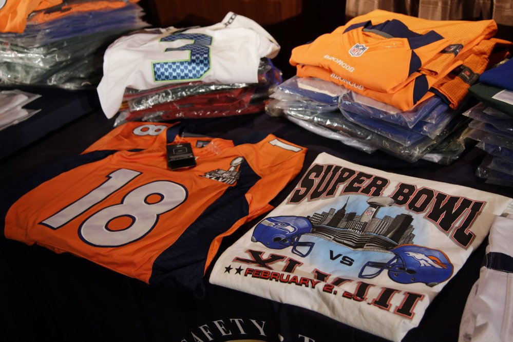 Seized counterfeit NFL merchandise is displayed before a news conference at the NFL Super Bowl XLVIII media center on Thursday in New York.