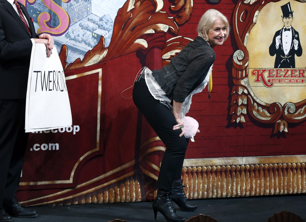 "Actress Helen Mirren ""twerks"" during her roast as woman of the year by Harvard University's Hasty Pudding Theatricals."