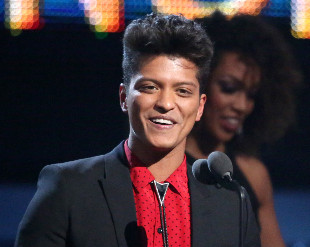 "Bruno Mars accepts the award for best pop vocal album for ""Unorthodox Jukebox"" at the Grammy Awards in Los Angeles on Sunday. Mars will perform at the Super Bowl halftime show Sunday."