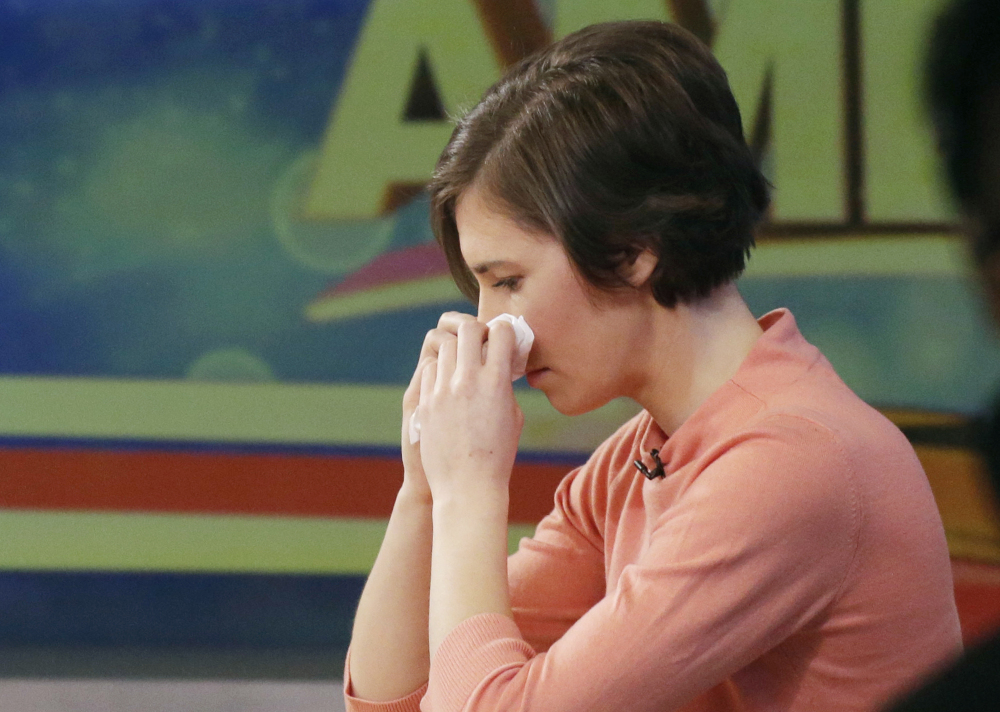 "Amanda Knox wipes her nose with a tissue while making an appearance Friday on ABC's ""Good Morning America."""