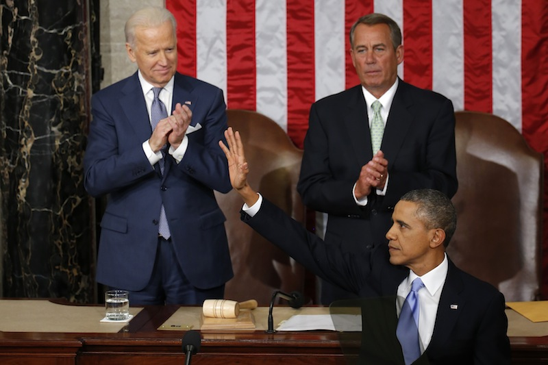 President Barack Obama waves after giving his State of the Union address on Capitol Hill in Washington, Tuesday Jan. 28, 2014. Vice President Joe Biden and House Speaker John Boehner of Ohio applaud.