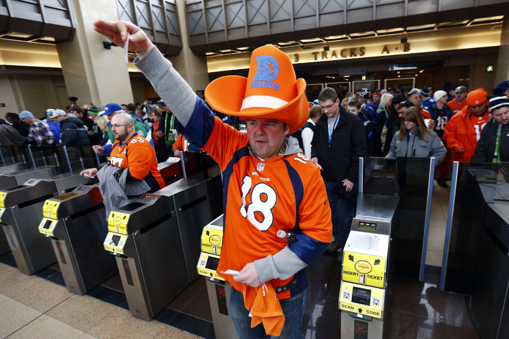 Football fans enter the Secaucus Junction, on Sunday in Secaucus, N.J. The Seattle Seahawks play the Denver Broncos in the Super Bowl XLVIII on Sunday evening at MetLife Stadium in East Rutherford, N.J.