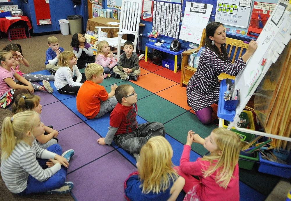 Jessica Gurney talks to her students before they start a writing workshop last fall at Manchester Elementary School.