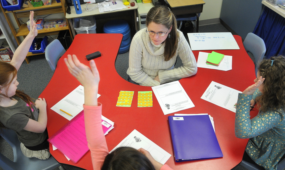 "TALKING NUMBERS: Readfield Elementary School third grade teacher Abby Shink leads her class Wednesday through a ""number talk,"" an instructional activity RSU 38 uses to get students to discuss and critique arguments in math, as required in the Common Core State Standards."