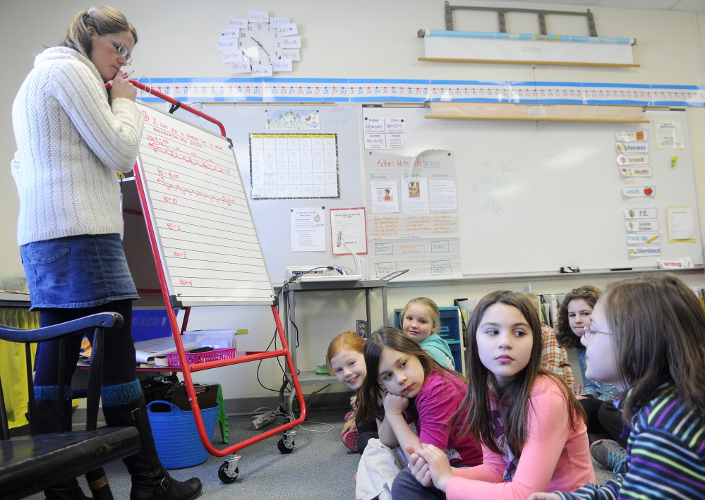 "TALKING NUMBERS: Readfield Elementary School third grade teacher Abby Shink listens Wednesday to her class work through an equation with a ""number talk,"" an instructional activity RSU 38 uses to get students to discuss and critique arguments in math, as required in the Common Core State Standards."