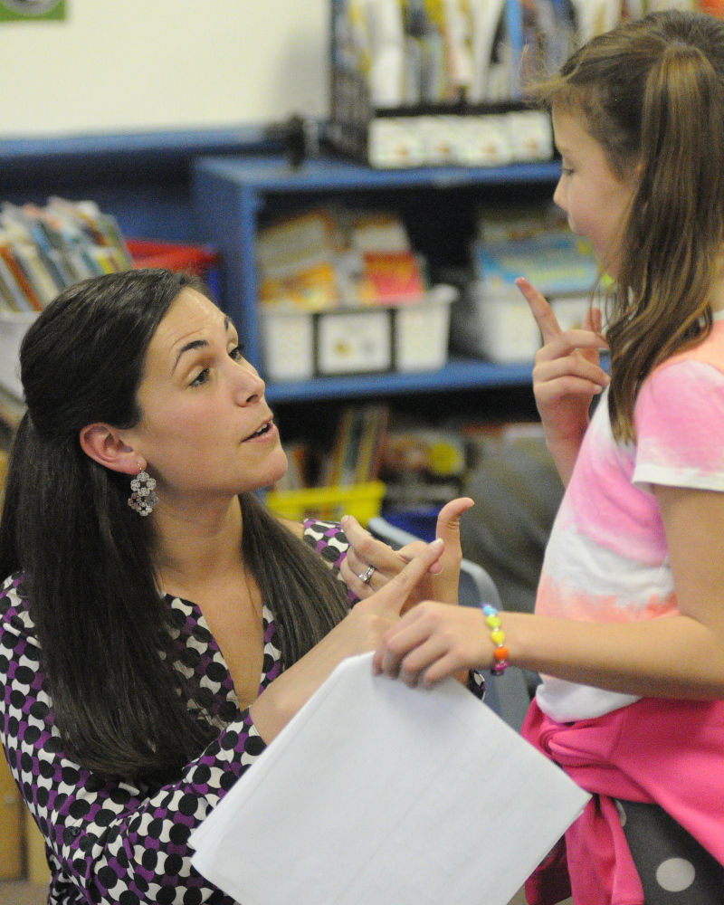 Jessica Gurney, left, talks with Grace Leach during a writing workshop last fall at Manchester Elementary School.