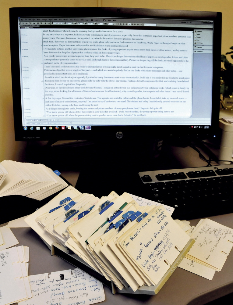 LESS PAPER: Paper and related items like a Rolodex are becoming overshadowed by computers and other mechanical means.