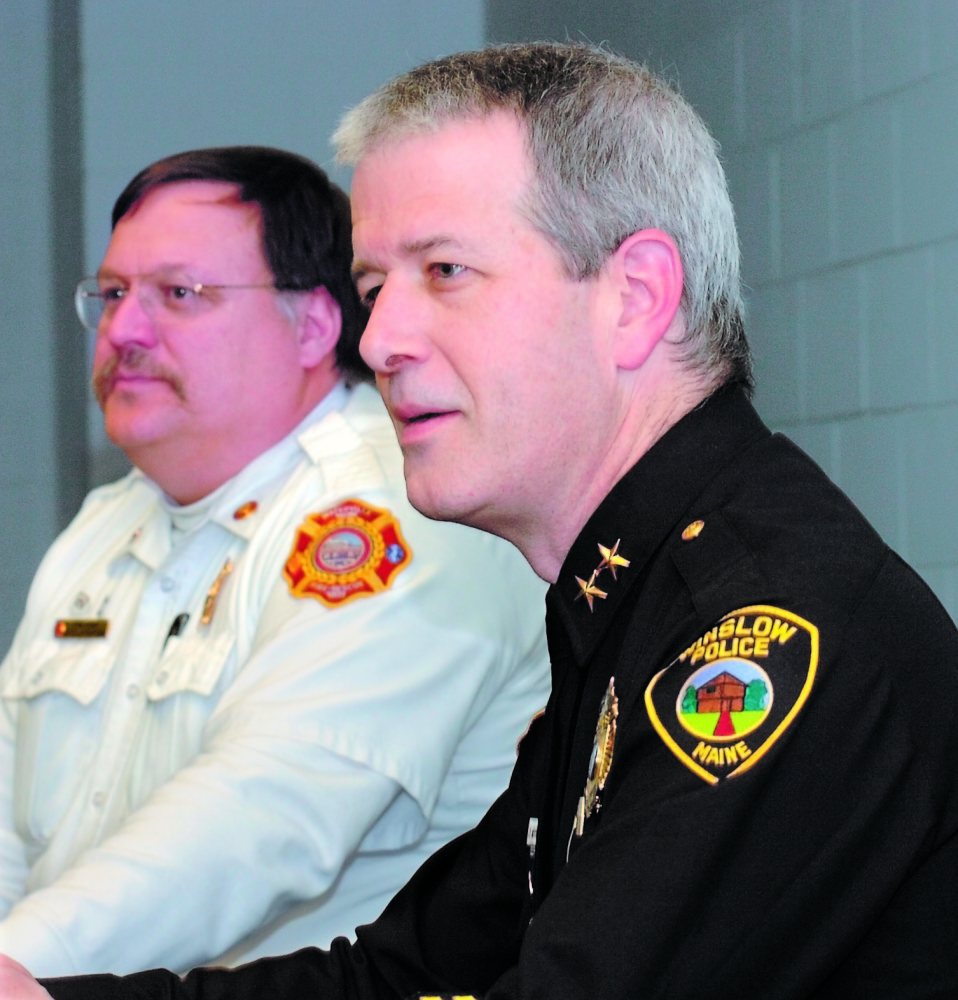 FORMER CHIEF: Jeffrey Fenlason, right, of the Winslow Police Department, attends a meeting in 2009 with other town officials shortly before he was named the town's police chief that year.