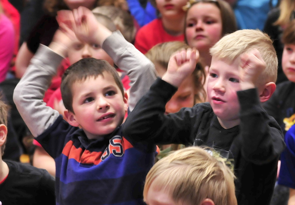 COOL SCHOOL: Cape Cod Hill School students Kenneth Ferrari, left, and Thomas Cormier move to the music of hip-hop artist and alumnus Devin Ferreira at the New Sharon school on Monday. The boys both said later they liked the energetic music.