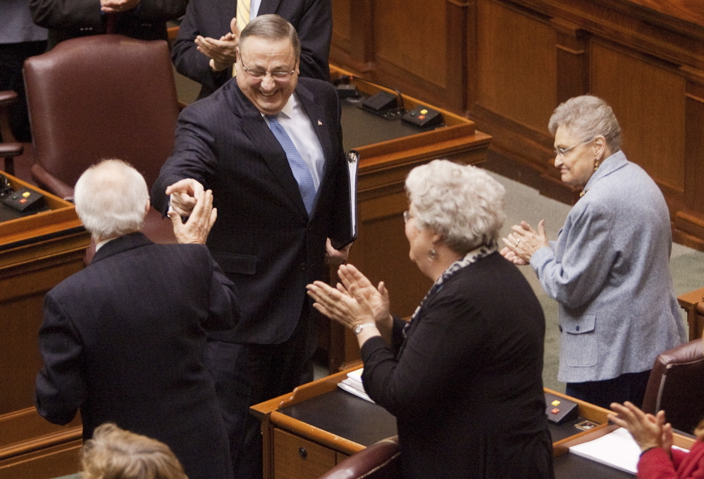 Governor Paul LePage jokes with Rep James J. Campbell, I-Newfield, while heading down the aisle to deliver his State of the State Address in the House Chambers at the State House in Augusta on Tuesday February 4, 2014.