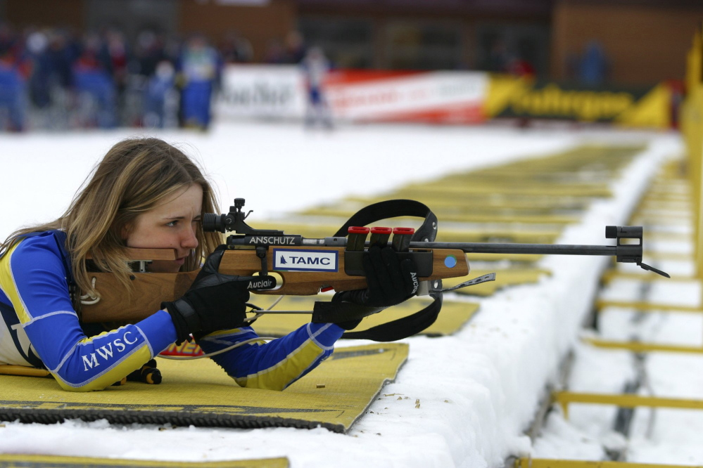 Wearing a Maine Winter Sports Center jersey, Meagan Toussaint of Madawaska takes aim with a rifle designed for use in the biathlon.