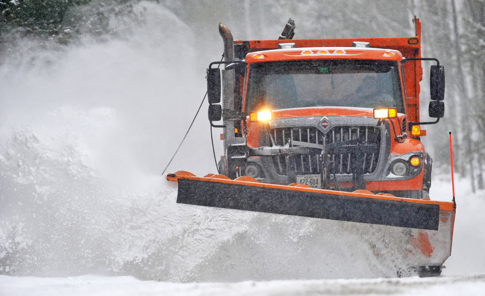 POW PLOW: A plow with the Waterville Public Works clears fresh snow from Quarry Road as a major storm moves through central Maine on Wednesday.