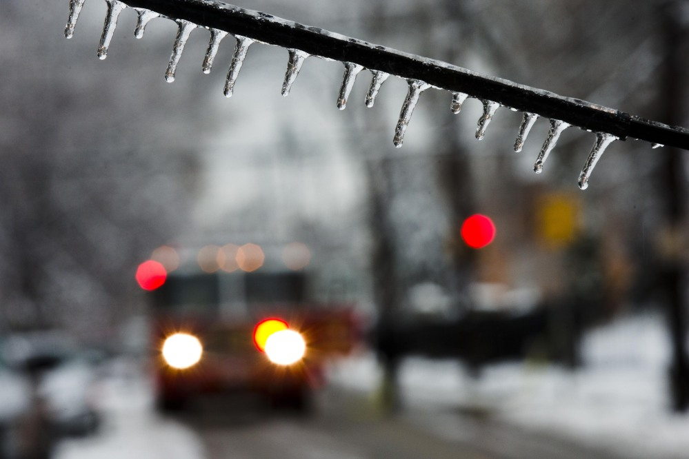 An ice-covered utility line blocks the path of a firetruck after a storm on Wednesday in Philadelphia. Icy conditions have knocked out power to more than 200,000 electric customers in southeastern Pennsylvania.