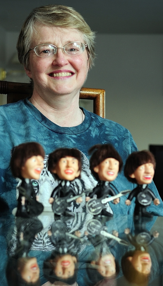 Staff photo by Joe Phelan FOND MEMORIES: Cindy Masiero, of China, still has the set of Beatles dolls she got as a child.