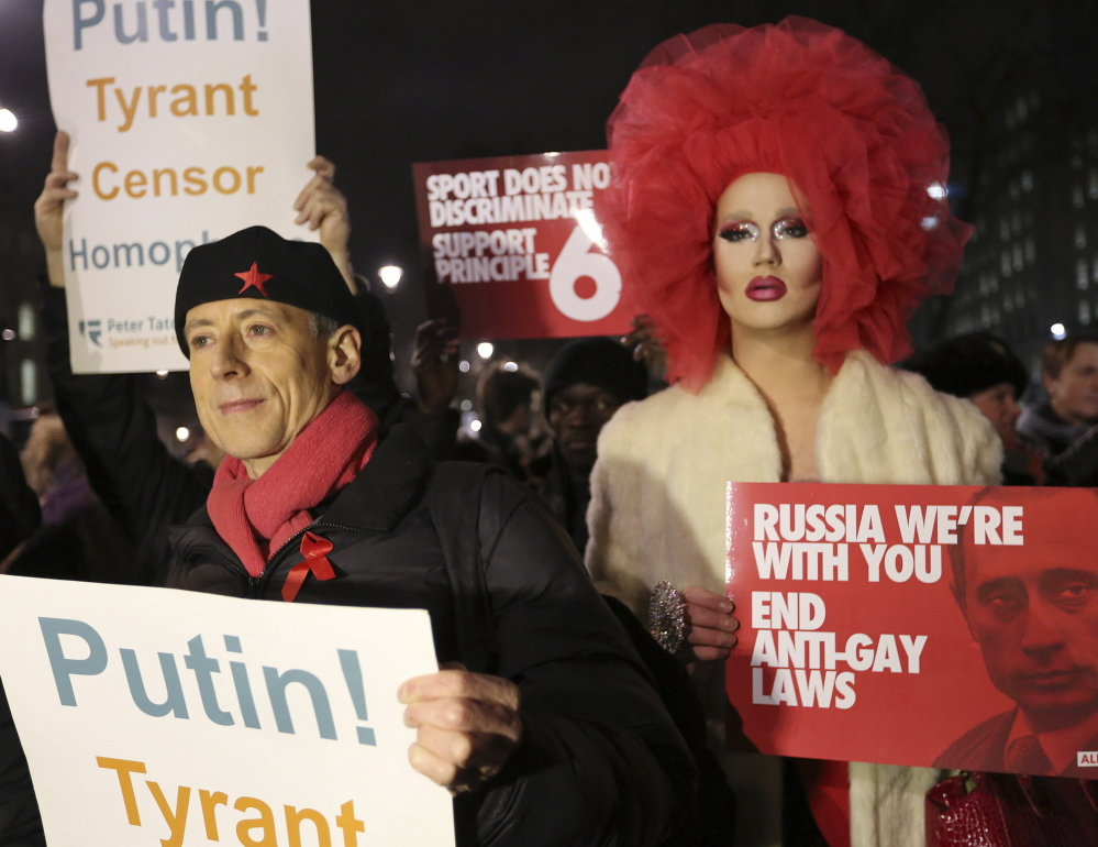 Demonstrators protest Russia's anti-gay policies in London on Tuesday. The protest was held as part of Global Speakout for Russia, which is taking place in more than 30 cities across the globe ahead of the Winter Olympic Games.