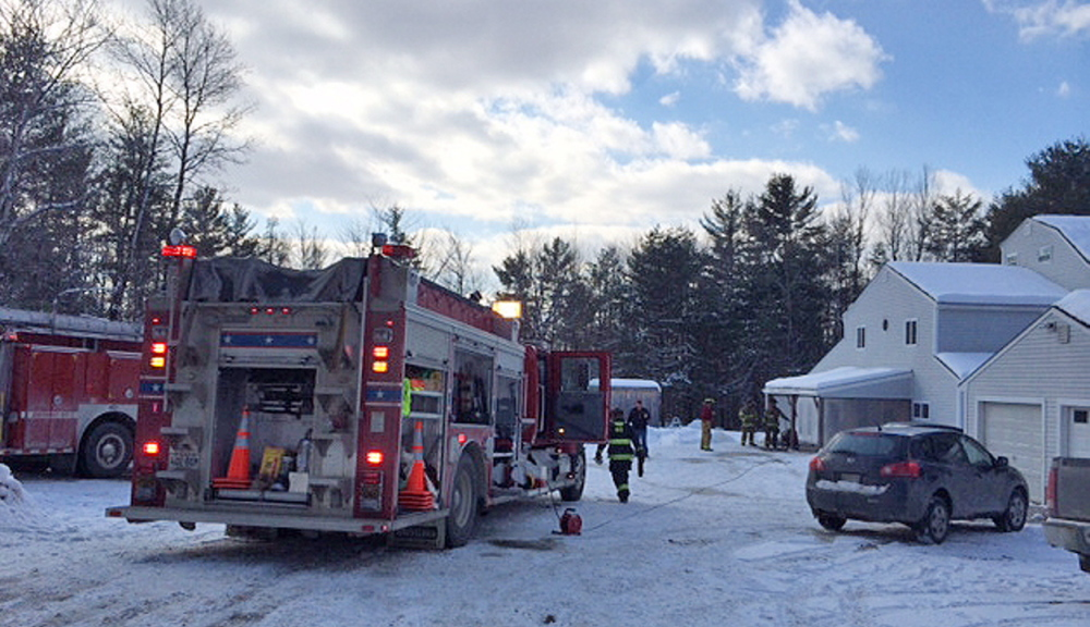 fire scene: Firefighters respond to a house fire Friday at 237 Shusta Road in Madison.