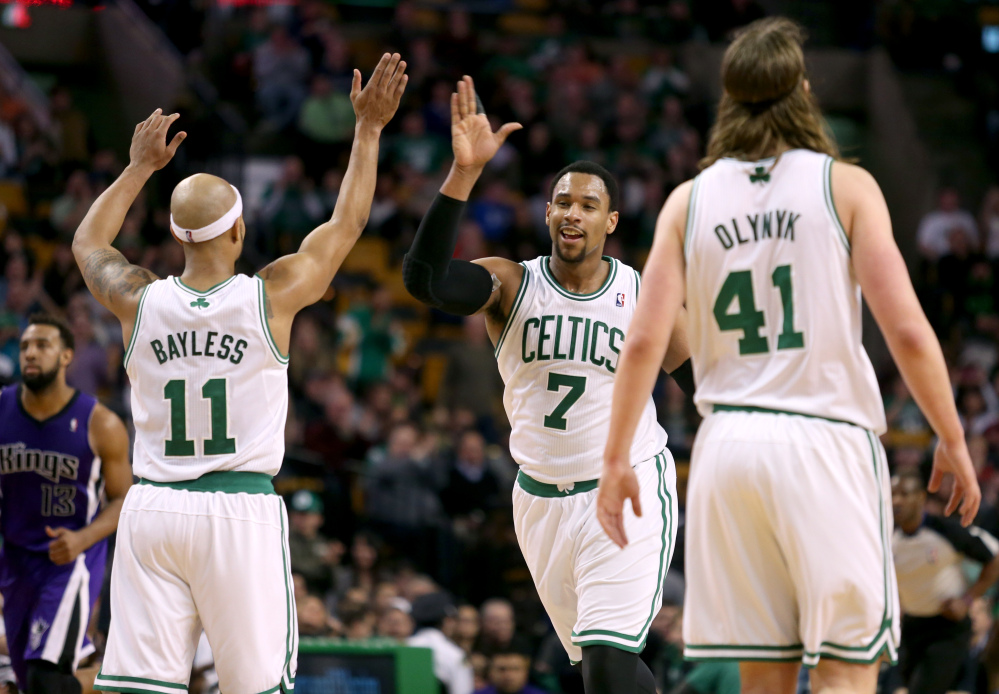 HIGH FIVE: Boston Celtics center Jared Sullinger (7) celebrates with teammates Jerryd Bayless (11) and Kelly Olynyk after scoring during the second half Friday against the Sacramento Kings in Boston. Sullinger scored 31 points and the Celtics won 99-89.