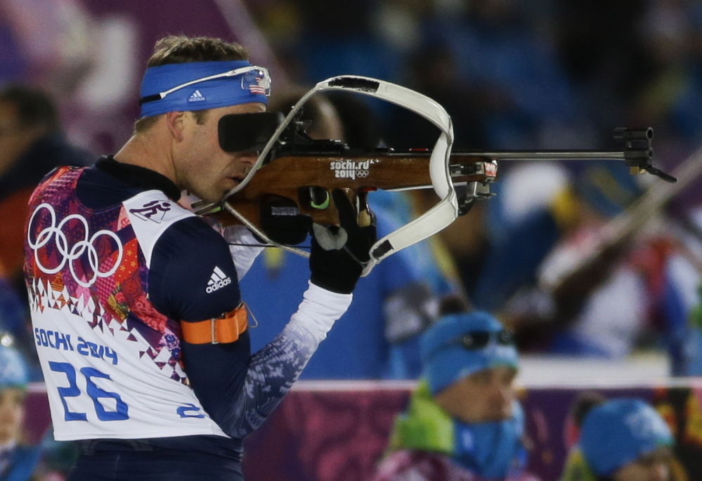 Lowell Bailey, who trains at the Maine Winter Sports Center, shoots during the men's biathlon 10k sprint at the Winter Olympics on Saturday. Bailey placed 35th in the event.