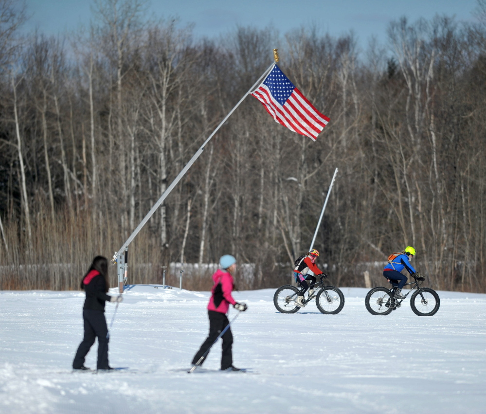 WINTER Fun: Snow mountain bikers and Nordic skiers shared the trail at Quarry Road Recreational Area in Waterville on Saturday during the annual Winter Carnival.